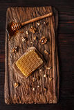 Honey on wooden board Stock Photography
