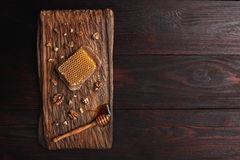 Honey on wooden board Royalty Free Stock Images
