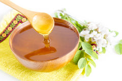 Honey in wooden bowl Royalty Free Stock Photography