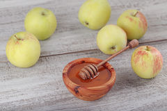 Honey in wooden bowl with honey dipper Stock Image