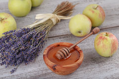 Honey in wooden bowl with honey dipper Royalty Free Stock Images