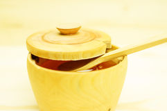 Honey in a wooden bowl Stock Images