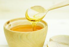 Honey in a wooden bowl Stock Image