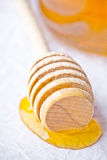 Honey on wooden honey dipper Royalty Free Stock Photography