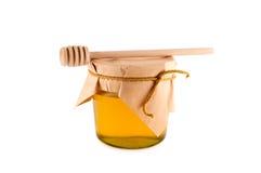 Honey wooden spoon isolated white. royalty free stock photos