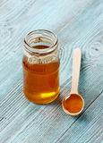 Honey in a wooden spoon and jar Royalty Free Stock Image