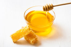 Honey with and wooden spoon Stock Photos