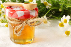 Honey on a wooden table royalty free stock photo