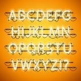 Honey Yellow Alphabet de neón que brilla intensamente Fotos de archivo