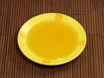 Honey in yellow plate. Stock Photography