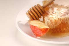 Honeycom and apple on a plate Royalty Free Stock Photo