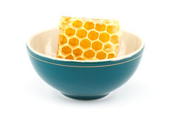 Honeycomb in bowl. Honeycomb in green porcelain bowl on white isolated background Royalty Free Stock Photo