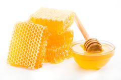 Honeycomb and a bowl of honey Stock Images