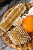 Honeycomb breakfast. Bread Egg Cream Royalty Free Stock Images