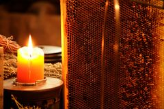 Honeycomb in candle light Stock Photo