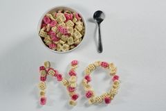 Honeycomb cereal arranged text no with bowl and spoon. On white background Stock Images