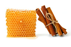 Honeycomb and cinnamon Royalty Free Stock Images