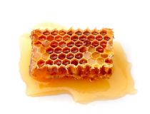 Honeycomb. Close up on a white background Royalty Free Stock Image