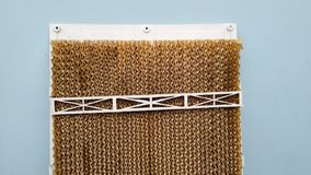 Honeycomb cooling pad system in cooler to cool the air with water stock image