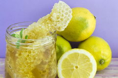 Honeycomb dipper and lemon close up Royalty Free Stock Photos