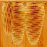 Honeycomb on frame. With wooden background Royalty Free Stock Photos