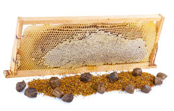 Honeycomb full of honey in wooden frame Royalty Free Stock Photos