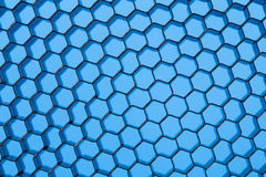 Honeycomb grid against blue background Royalty Free Stock Images