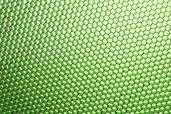 Honeycomb grid against green background Royalty Free Stock Photo