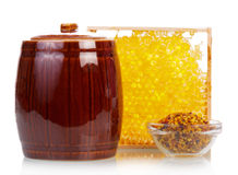 Honeycomb with honey jar Stock Images