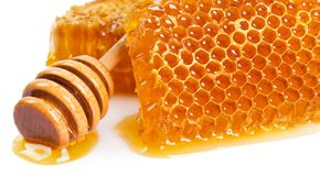 Honeycomb with honey on white background royalty free stock photo
