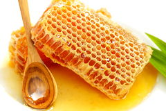 Honeycomb with honey on the white. Royalty Free Stock Photos