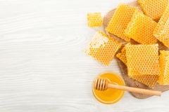 Honeycomb with honey on a wooden board. View from above. Copy space Stock Images