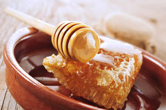 Honeycomb with honey on a wooden surface Royalty Free Stock Photo