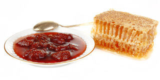 Honeycomb with jam Stock Photography