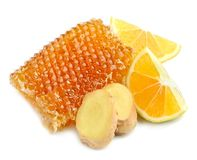 Honeycomb with lemon and ginger royalty free stock images