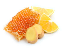 Honeycomb with lemons and ginger root Stock Photo