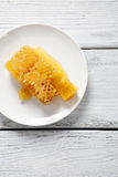 Honeycomb on a plate Stock Photos
