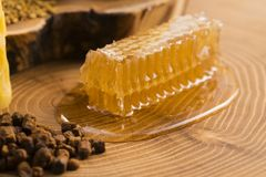 Honeycomb, pollen and propolis. On wooden background Royalty Free Stock Images