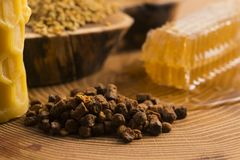 Honeycomb, pollen and propolis. On wooden background Royalty Free Stock Photo