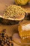 Honeycomb, pollen and propolis. On wooden background Stock Image