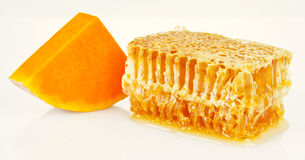 Honeycomb and pumpkin Royalty Free Stock Photo