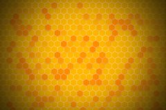 Honeycomb random Grid background or Hexagonal cell texture. In yellow honey bee tone style.  With vignette dark border shadow stock illustration