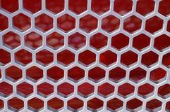 Honeycomb Shaped Structure. Red and siver honey comb shapped structure stock photo