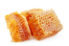 Honeycomb slice closeup on white royalty free stock photo