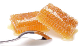 Honeycomb with spoon. On white Stock Photo
