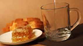 Honeycomb and tea mug stock video