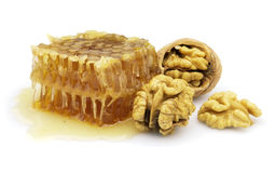 Honeycomb and walnuts Royalty Free Stock Photo