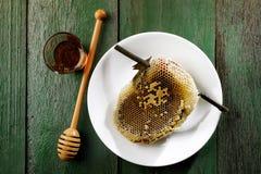 Honeycomb on white dish Stock Photos