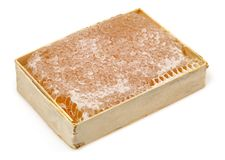 Honeycomb in wooden frame isolated on white. Background stock photo