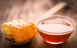 Honeycomb in a wooden spoon Royalty Free Stock Photo
